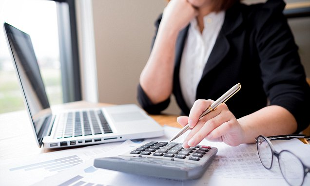 Asian female accountant or banker making calculations. Savings, finances and economy concept through a laptop.; Shutterstock ID 560877814